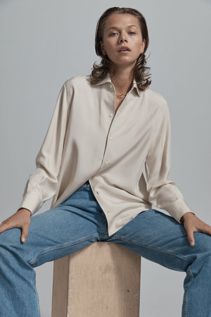 beige silk shirt sitting