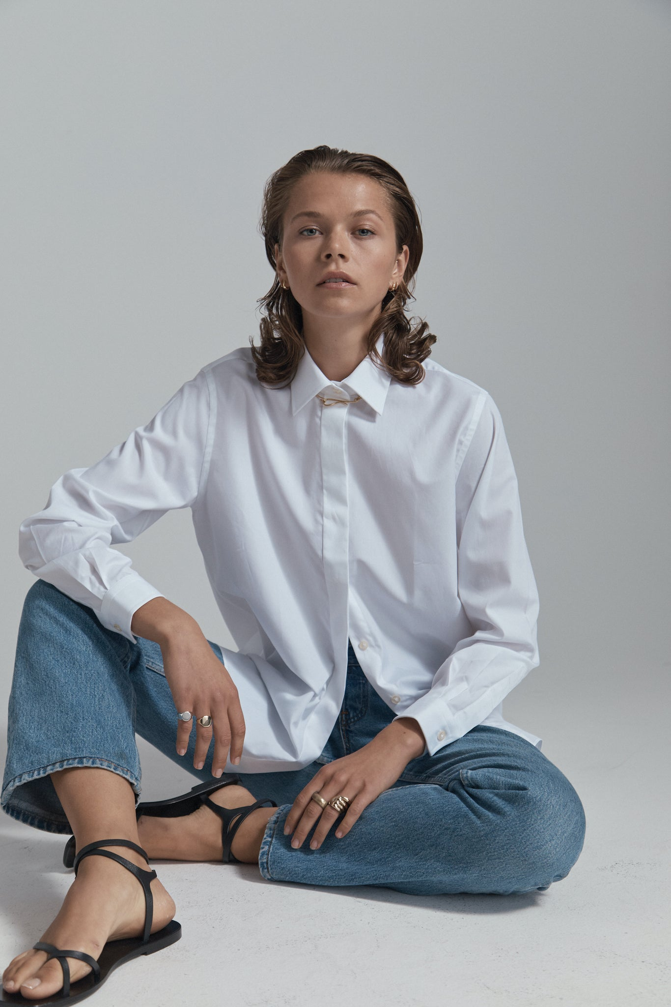 white shirt sitting