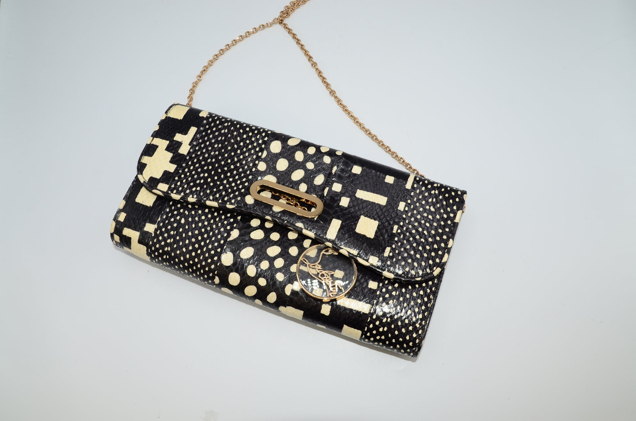 Christian Louboutin Riviera Clutch - Iconics Preloved Luxury