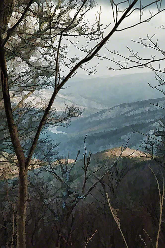 Winter branches frame a view of blue tinged mountains dotted with patches of snow on a cloudy day.   Branches in Abstract by Alison Thomas of Serenity Scenes Photography and Digital Art.