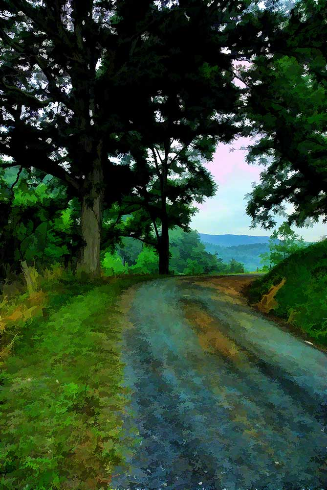 A gravel road winds through the mountains.  A mountain view with just a hint of pink in the sky lies just ahead.  Mountain Road by Alison Thomas of Serenity Scenes Photography and Digital Art.