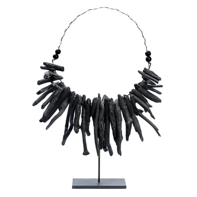 The Black Driftwood Necklace on stand