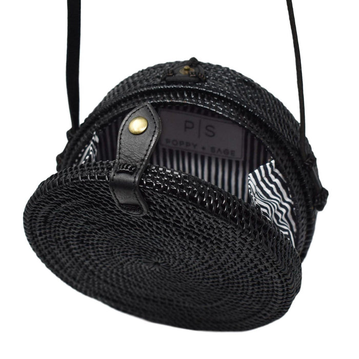 Poppy and Sage black circle rattan straw shoulder bag handmade in Bali. Black and white stripe.