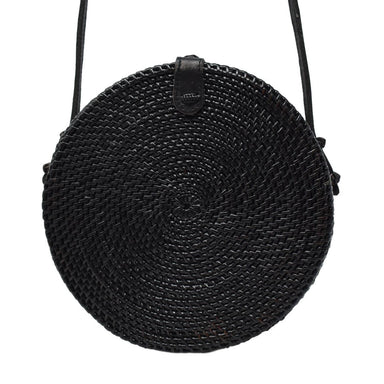 Poppy and Sage black circle rattan straw shoulder bag handmade in Bali.