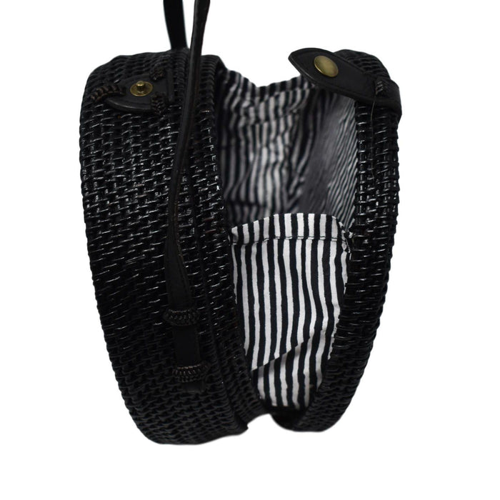 Poppy and Sage black circle rattan straw shoulder bag handmade in Bali. Black and white stripe side