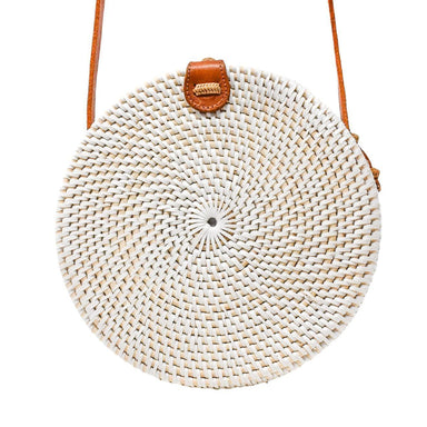 Poppy and Sage white circle rattan straw shoulder bag handmade in Bali.