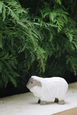wooden sheep toy among bushes - hiatus home