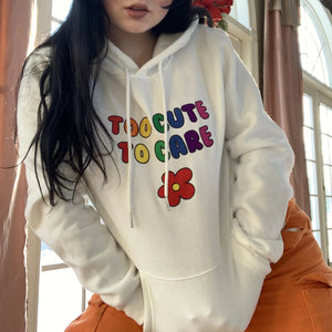 """TOO CUTE TO CARE"" EMBROIDERED HOODIE"