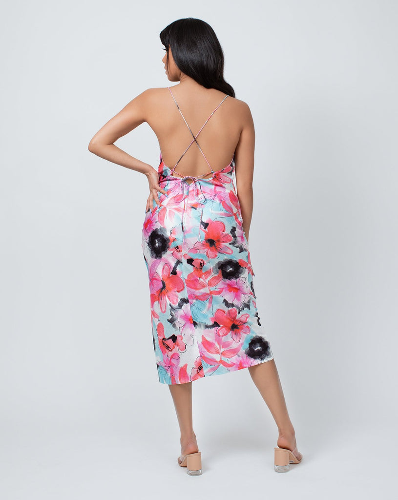 Woman in mid length floral slip