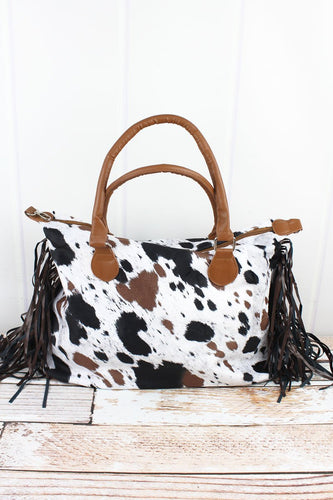 On The Moove Cow Print Tassel Tote