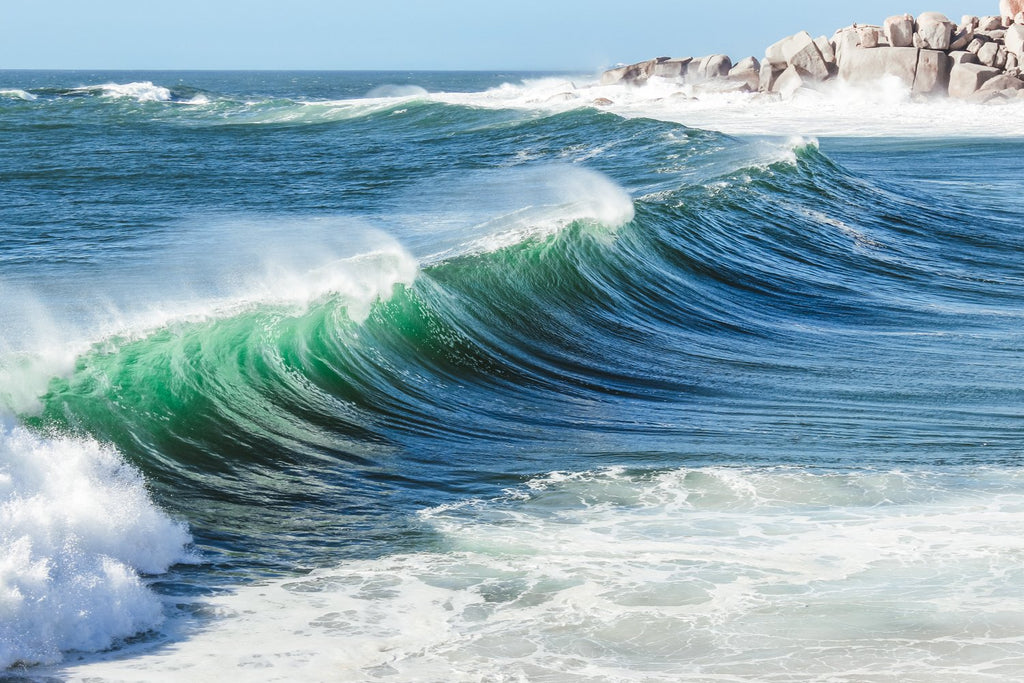Wave breaking at Llandudno beach in Cape Town