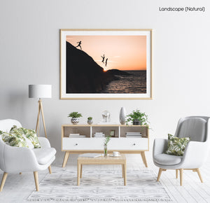 Three guys cliff jumping at sunset into ocean at Llandudno Beach in a natural fine art frame