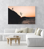 Three guys cliff jumping at sunset into ocean at Llandudno Beach in an acrylic/perspex frame