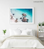Aerial rocks on clifton beach in clear blue water in a white fine art frame