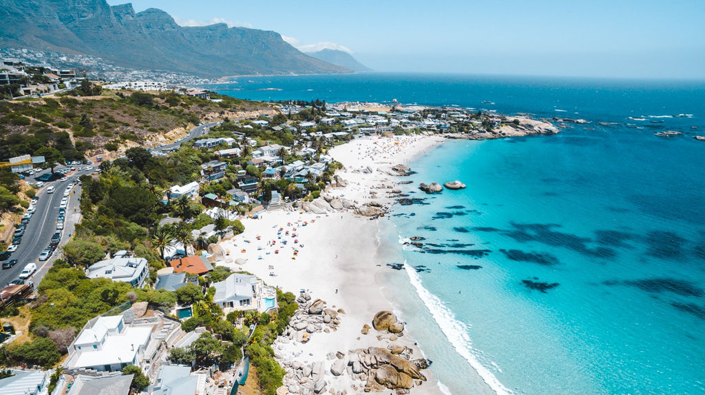 Aerial Clifton beach along Cape Town coast on a summers day