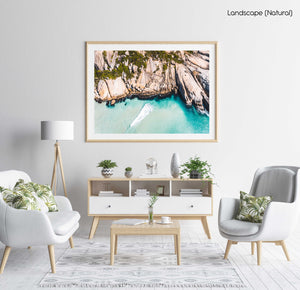 Aerial small wave breaking along Llandudno Beach in Cape Town in a natural fine art frame