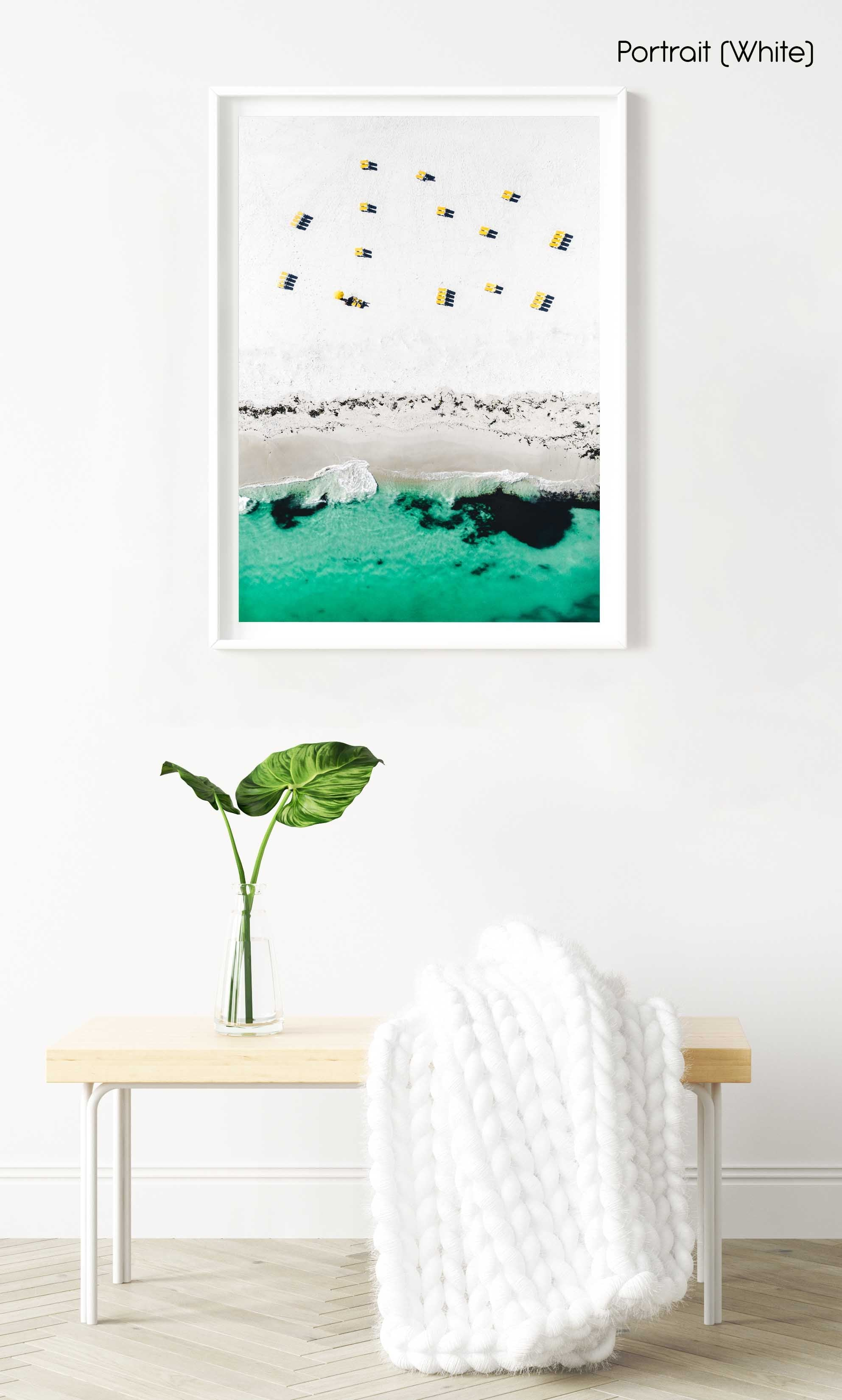 Aerial yellow beach chairs on Campsbay beach in Cape Town in a white fine art frame