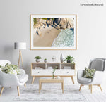 Two people playing beach bats on Llandudno Beach in Cape Town from an aerial perspective in a natural fine art frame