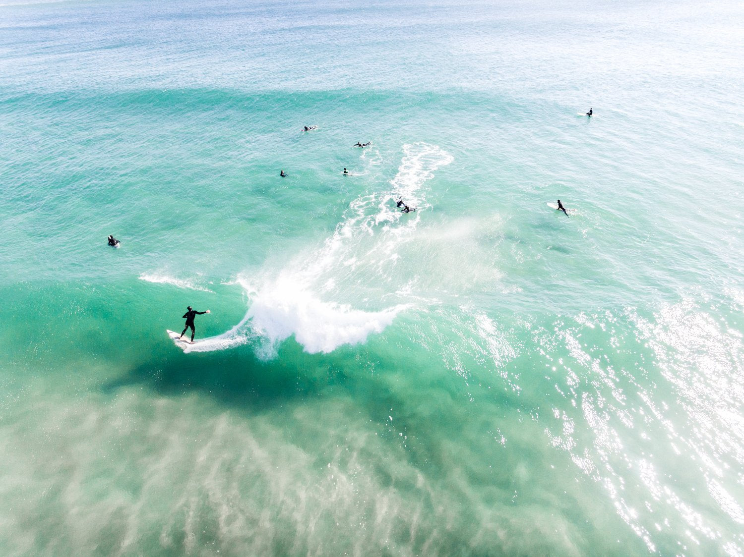 Aerial of surfer carving on a green wave taken at Llandudno Beach in Cape Town