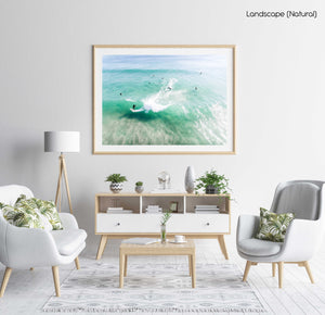 Aerial of surfer carving on a green wave taken at Llandudno Beach in Cape Town in a natural fine art frame