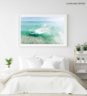 Aerial of surfer carving on a green wave taken at Llandudno Beach in Cape Town in a white fine art frame