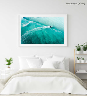 Three people surfing blue wave in Cape Town from above in a white fine art frame