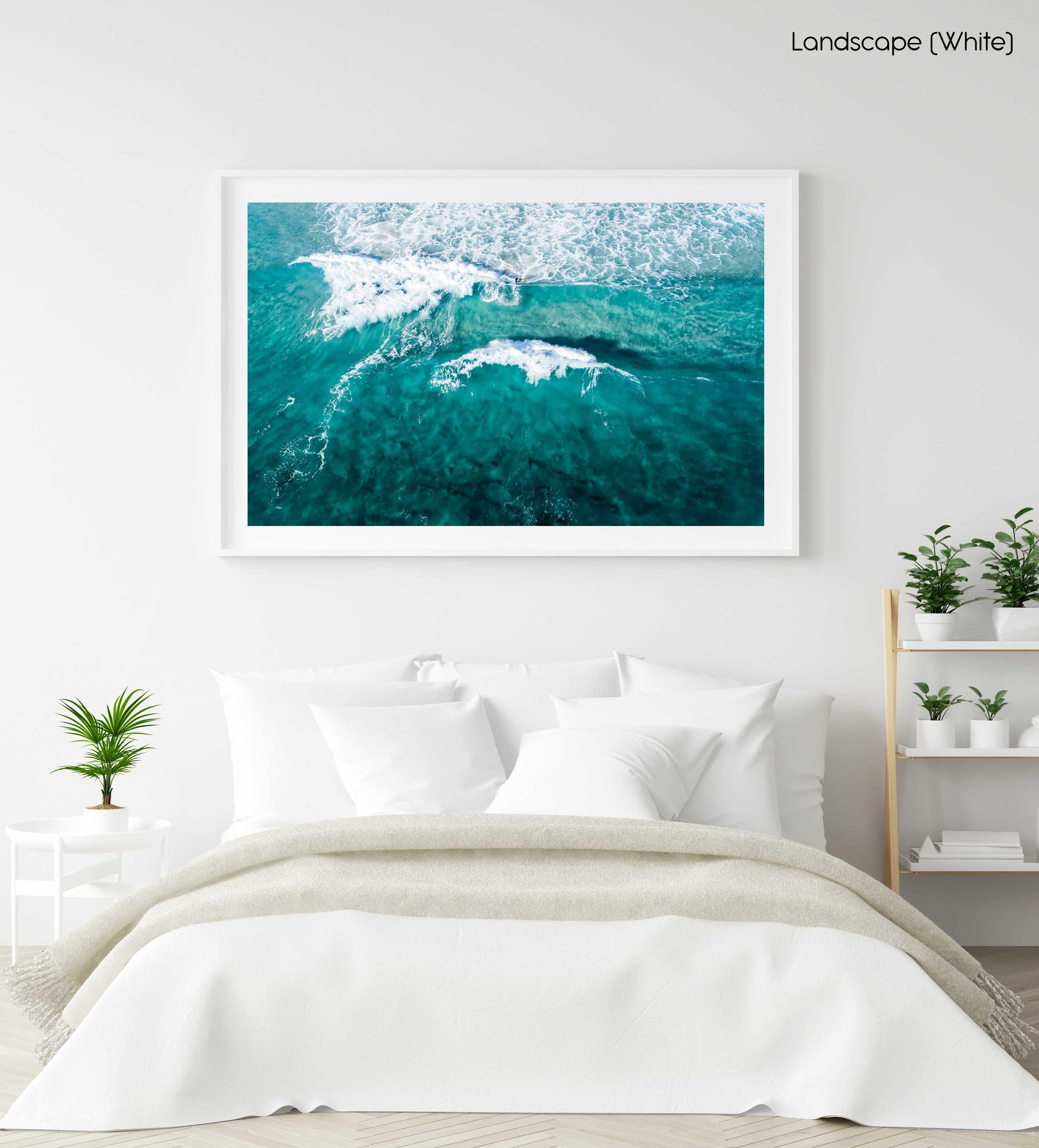 Aerial of two waves breaking in blue ocean in Cape Town in a white fine art frame