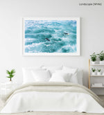 Aerial of two surfers paddling in foamy waves in a white fine art frame