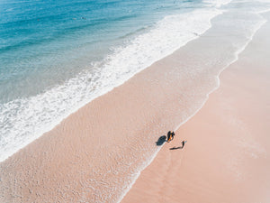 Aerial of father and daughter playing on Cape Town beach