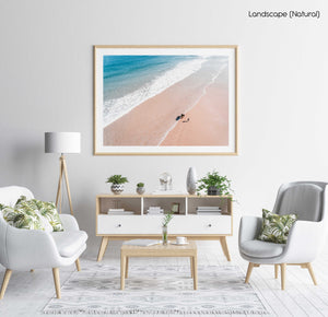 Aerial of father and daughter playing on Cape Town beach in a natural fine art frame