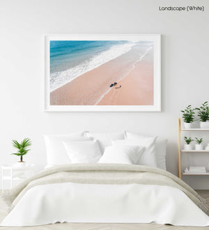Aerial of father and daughter playing on Cape Town beach in a white fine art frame