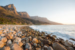 Pebbles and the sea at the twelve apostles mountains in Cape Town