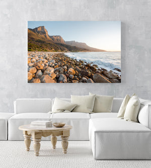 Pebbles and the sea at the twelve apostles mountains in Cape Town in an acrylic/perspex frame