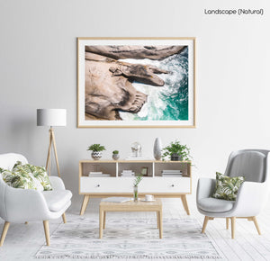 Modern shaped boulders in the ocean in Cape Town aerial in a natural fine art frame