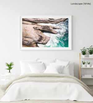 Modern shaped boulders in the ocean in Cape Town aerial in a white fine art frame