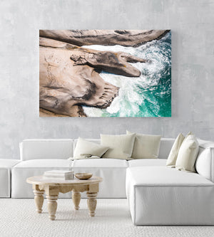 Modern shaped boulders in the ocean in Cape Town aerial in an acrylic/perspex frame