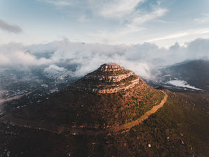 Aerial little lions head in hout bay at sunset in clouds