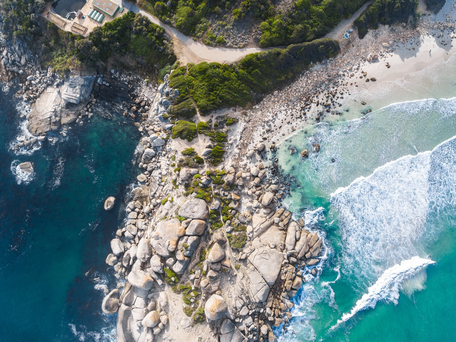 Aerial boulders in sea in Llandudno Beach Cape Town