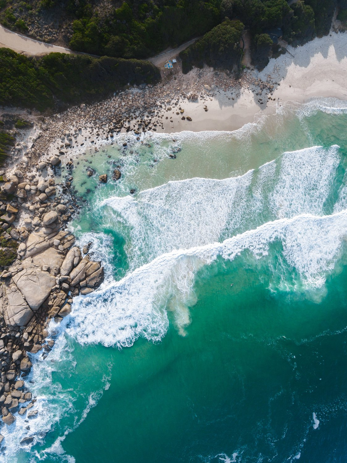 Dark green and blue ocean waves in Llandudno beach Cape Town aerial