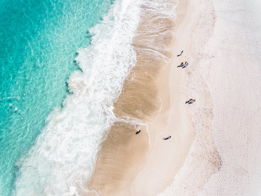 Aerial blue water and people walking on Camps Bay beach Cape Town