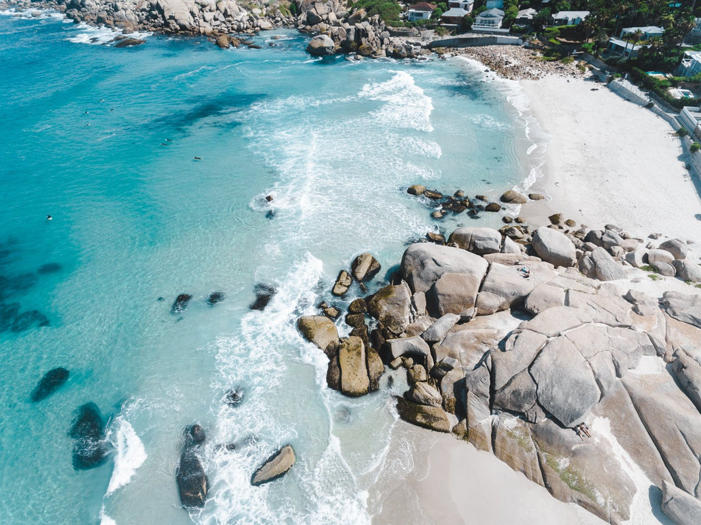 Aerial of blue Glen Beach surf in Cape Town