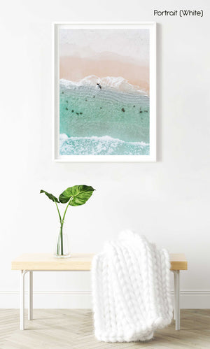 Aerial topdown of surfer walking out of water in Cape Town in a white fine art frame