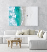 Aerial of two surfers sitting on Glen Beach in Cape Town in a white fine art frame