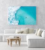 Aerial of surfer paddling in bright blue water in Cape Town in an acrylic/perspex frame