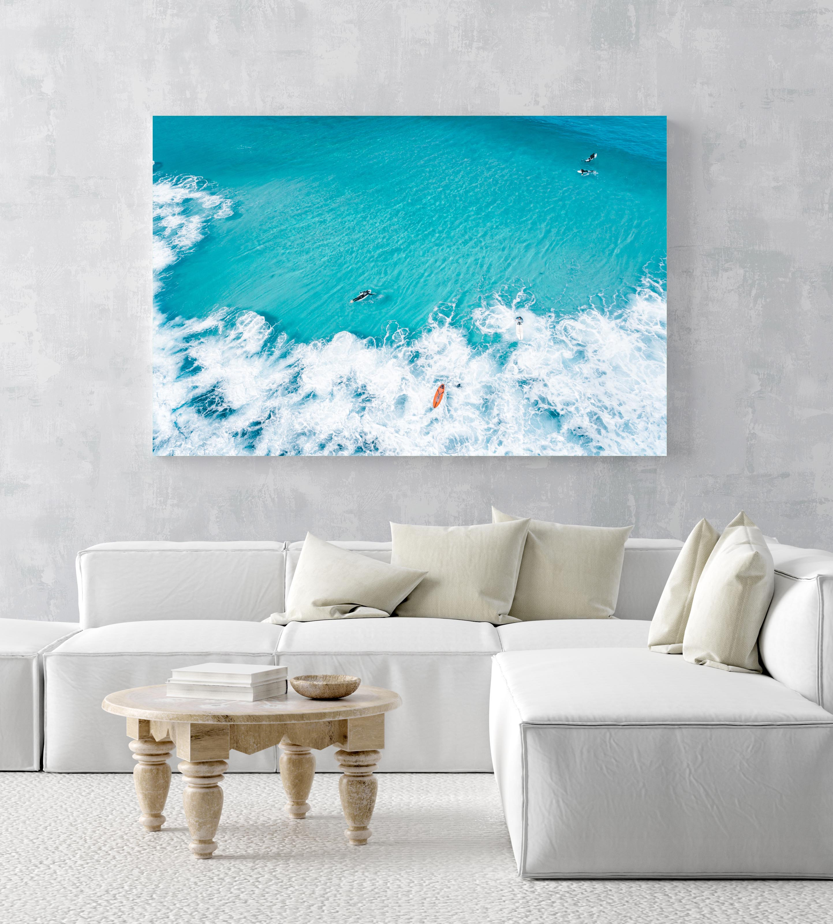 Aerial of surfers and waves in very blue waves in Cape Town in an acrylic/perspex frame