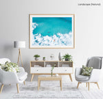 Aerial of surfers and waves in very blue waves in Cape Town in a natural fine art frame