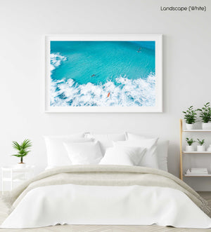 Aerial of surfers and waves in very blue waves in Cape Town in a white fine art frame