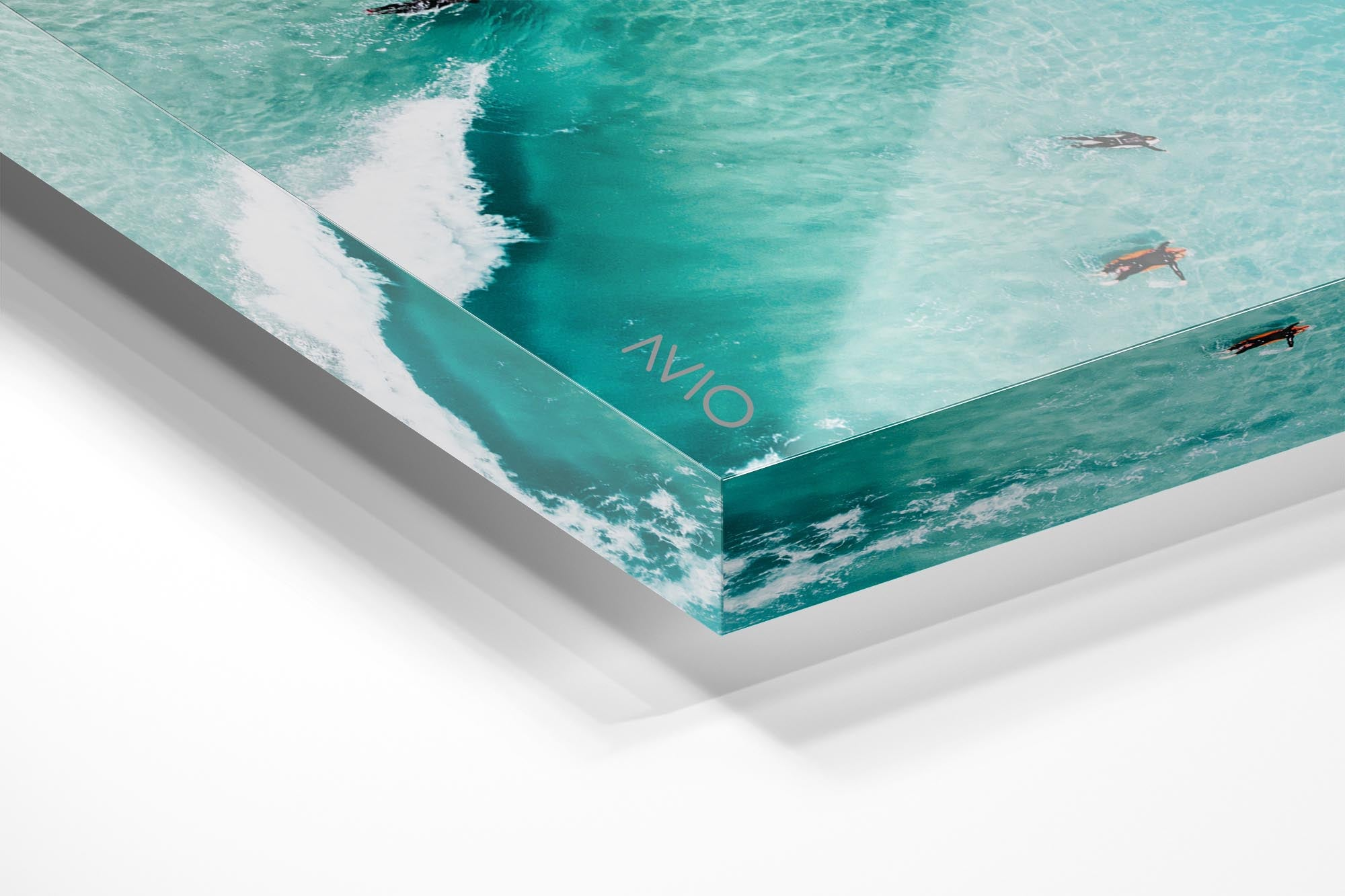 Aerial of surfers duckdiving blue wave at Glen Beach in Cape Town in an acrylic/perspex frame