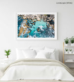 Aerial of blue water and rocks along Camps Bay in Cape Town in a white fine art frame