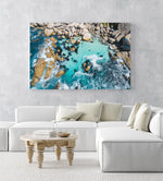 Aerial of blue water and rocks along Camps Bay in Cape Town in an acrylic/perspex frame